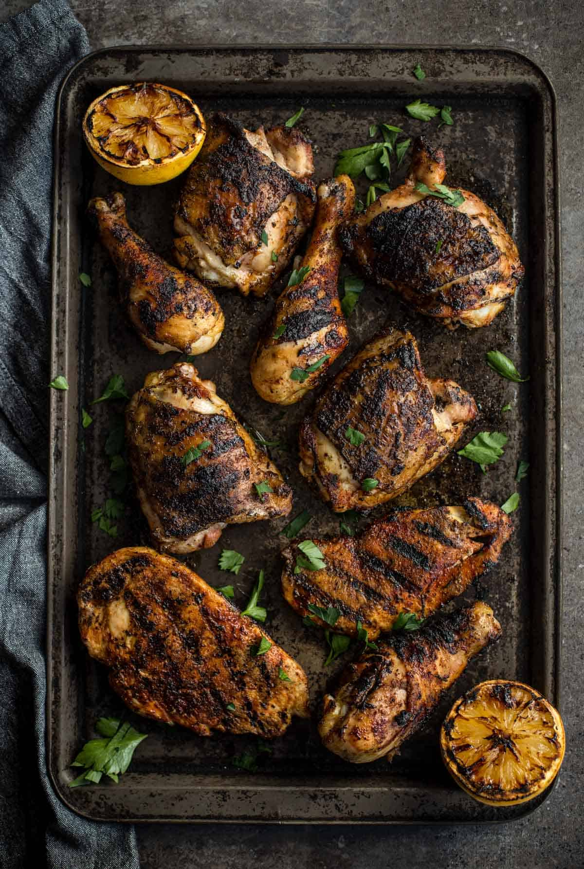 Grilled Jerk Chicken pieces on a sheet-pan