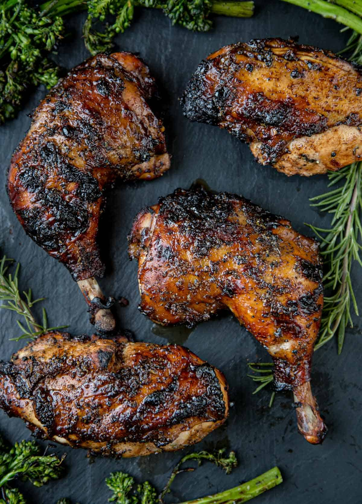 Pieces of Grilled Balsamic Glazed Chicken on a black platter