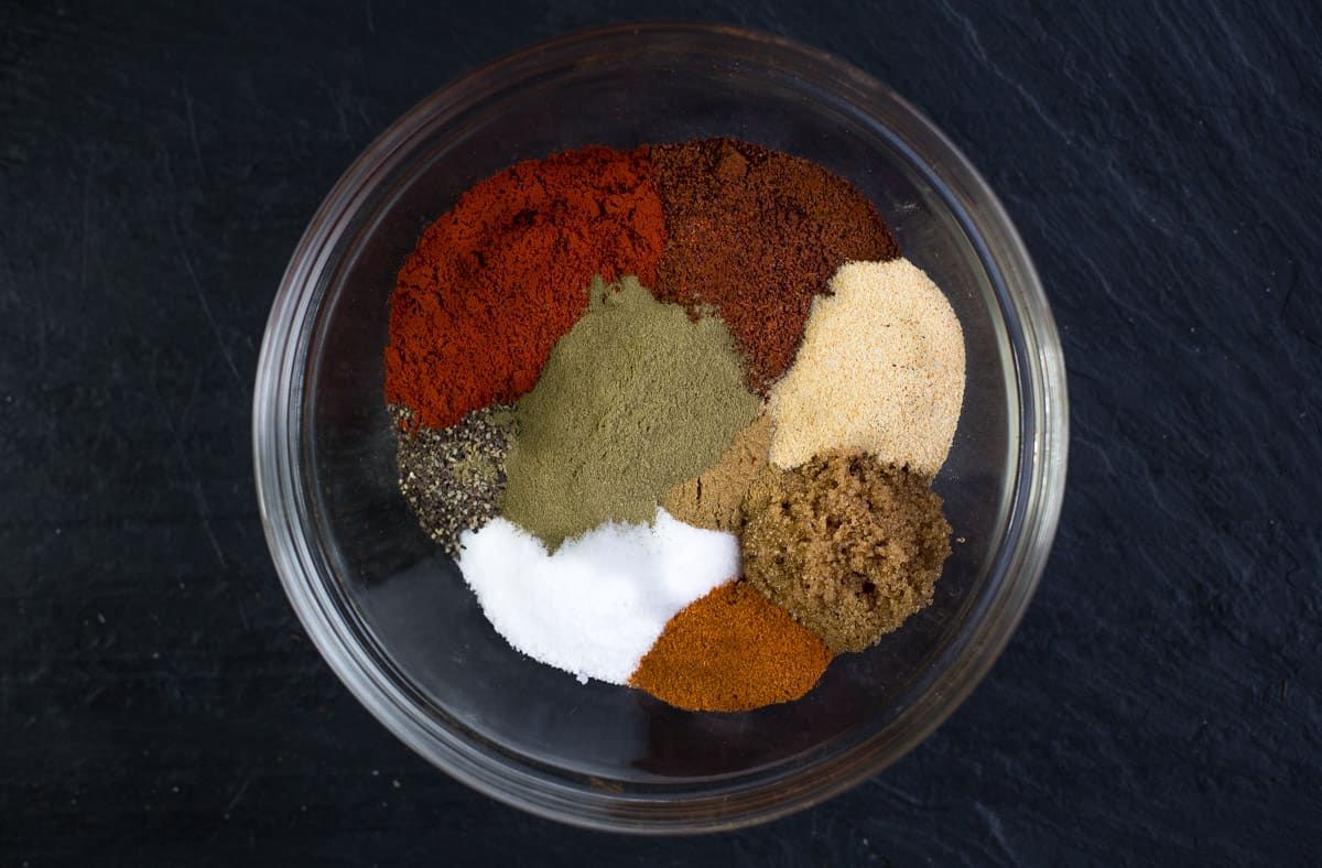Ingredients for blackening seasoning in a glass bowl