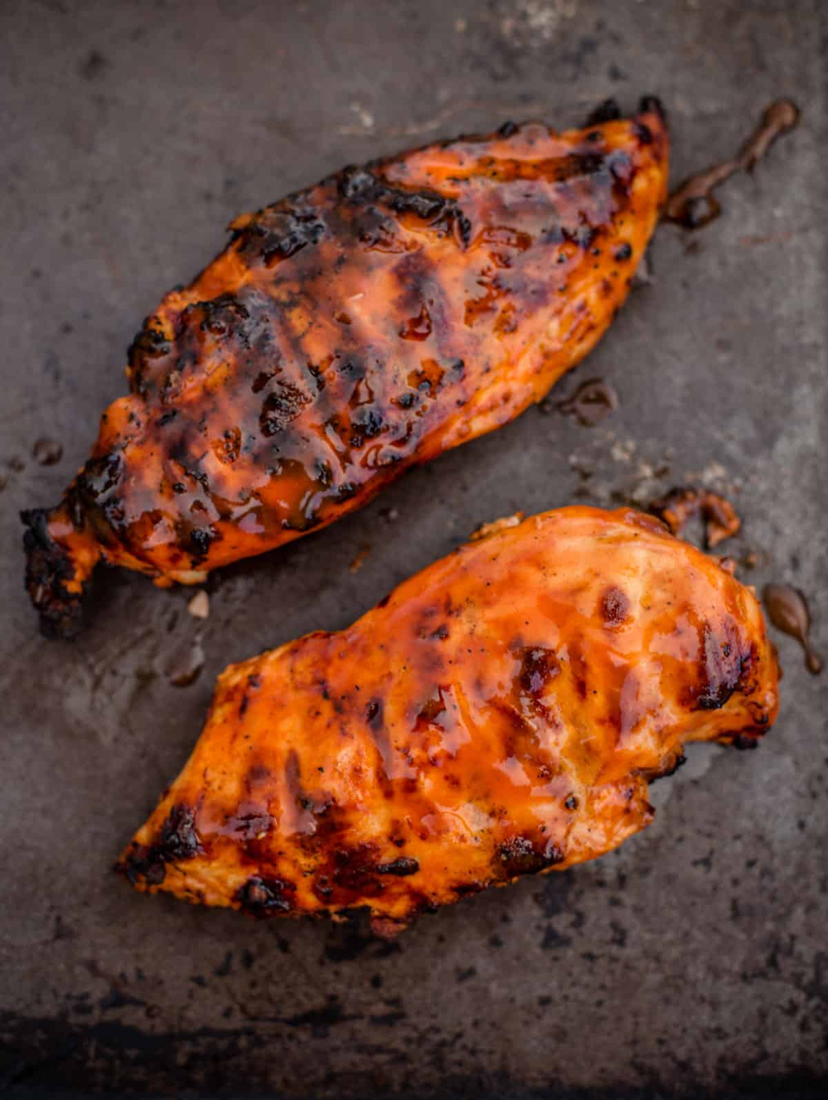 2 Grilled Buffalo Chicken Breasts on a sheetpan