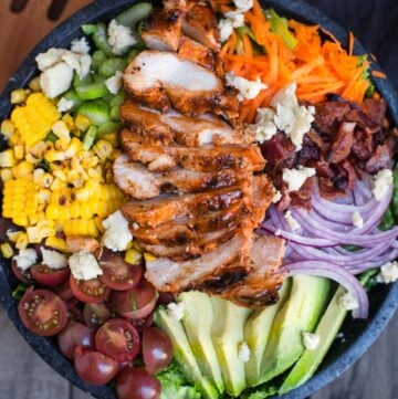 Grilled Buffalo Chicken Salad in a large black serving bowl