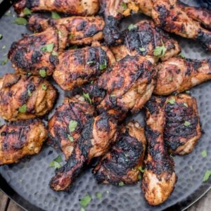 Pieces of grilled Jerk Chicken on a platter