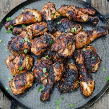 Spicy and aromatic Jerk chicken on a platter.