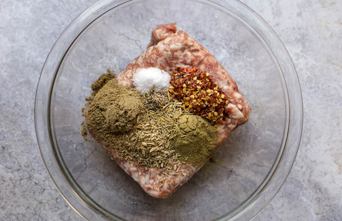 A bowl with breakfast sausage seasoning ingredients.