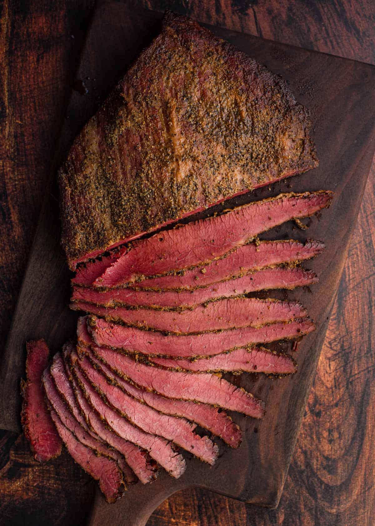 Smoked Corned Beef Brisket Flat on cutting board sliced.