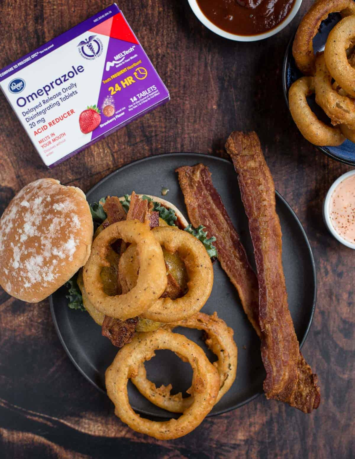 Beer battered onion rings and western style burger with bacon. Sponsored by Omeprazole ODT.