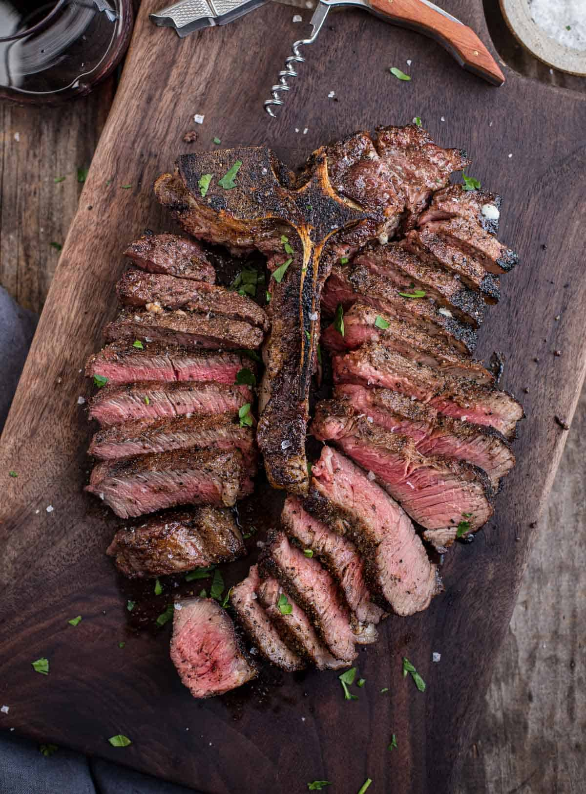 Sliced Porterhouse Steak paired with a glass of Sangiovese wine