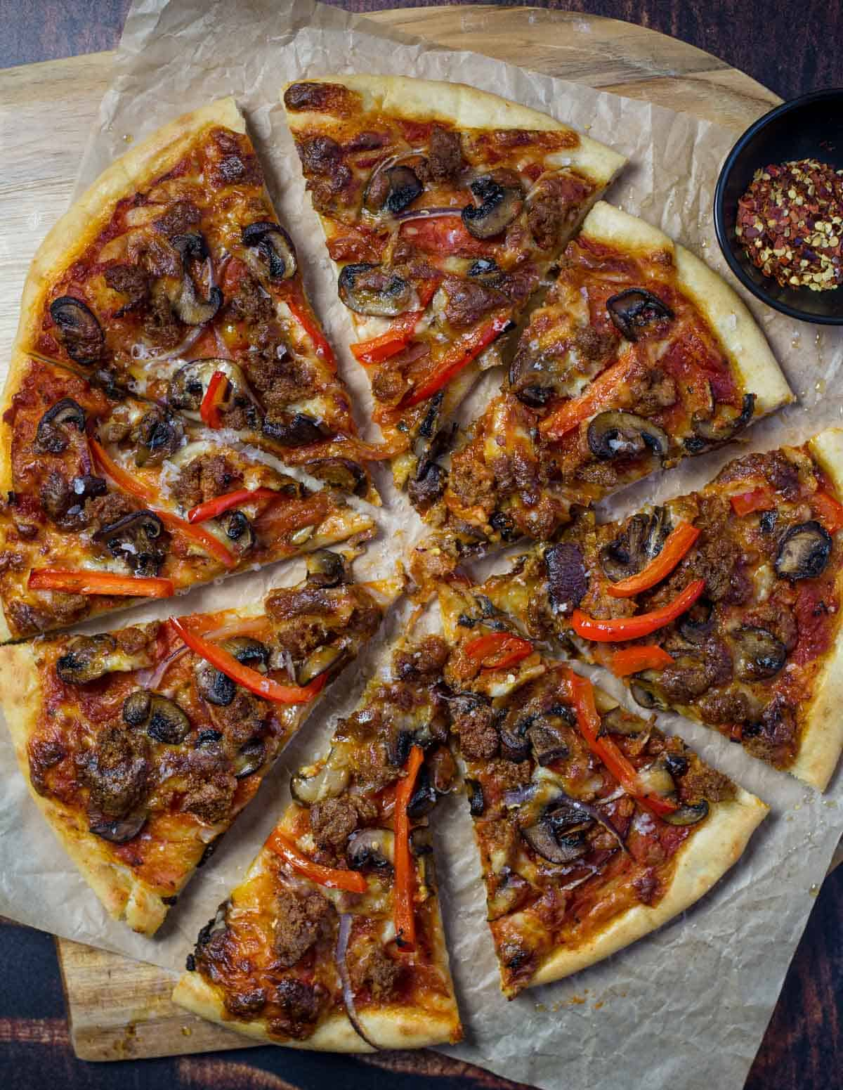Sausage, mushroom, and peppers pizza cooked on a pellet grill