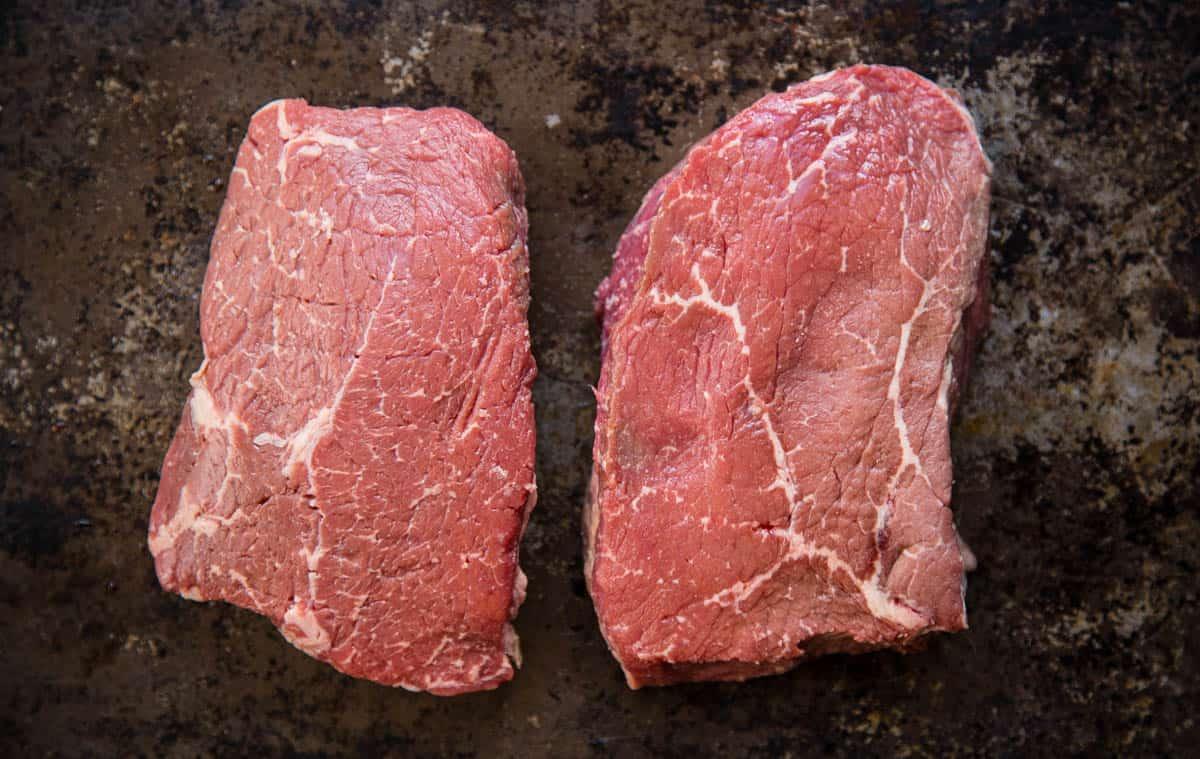 Two sirloin steaks on a plate