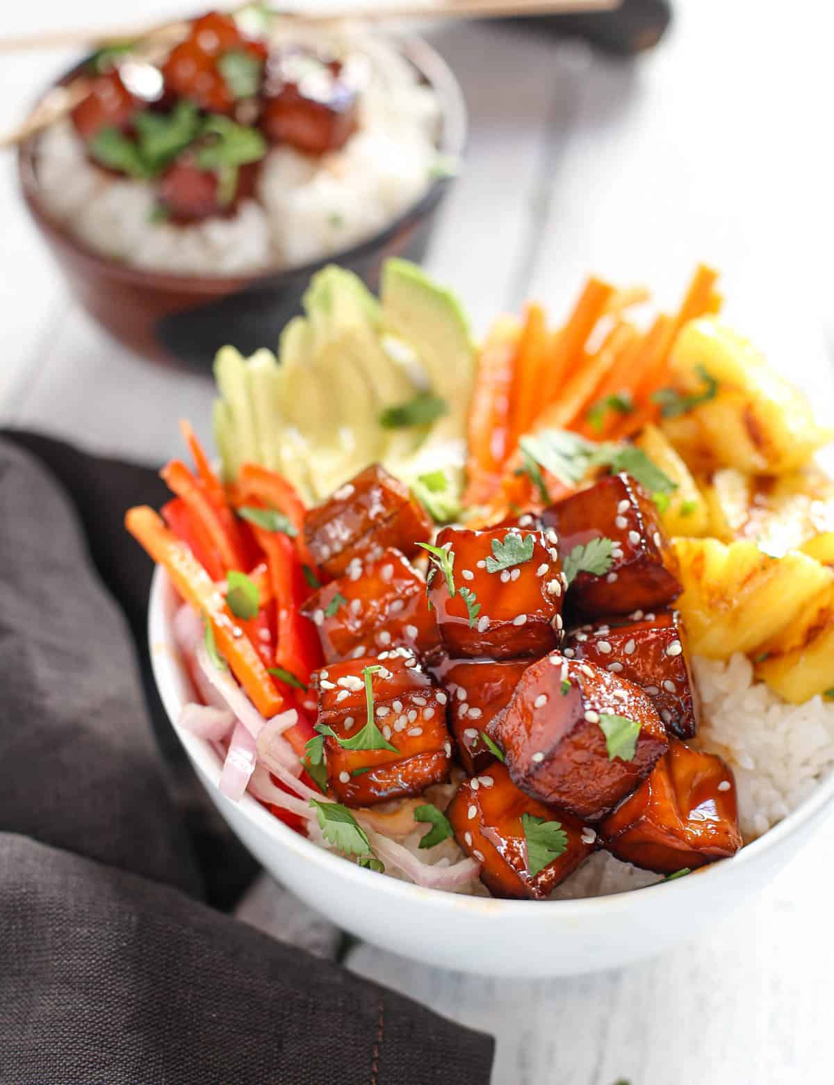 Smoked BBQ Tofu Bowls with vegetables and grilled pineapple in a white bowl