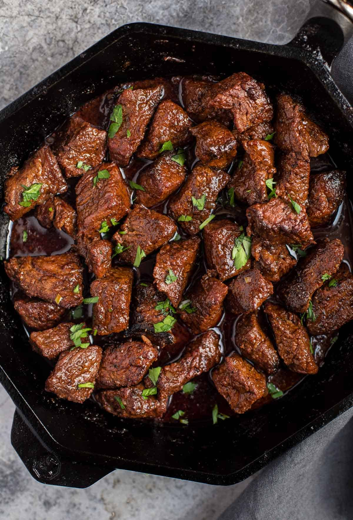 Grilled Steak Bites in a cast iron pan