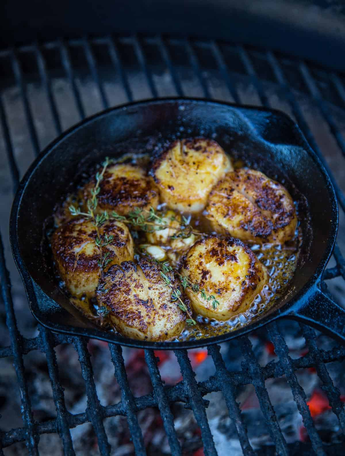 Grilled U10 scallops in a cast iron pan