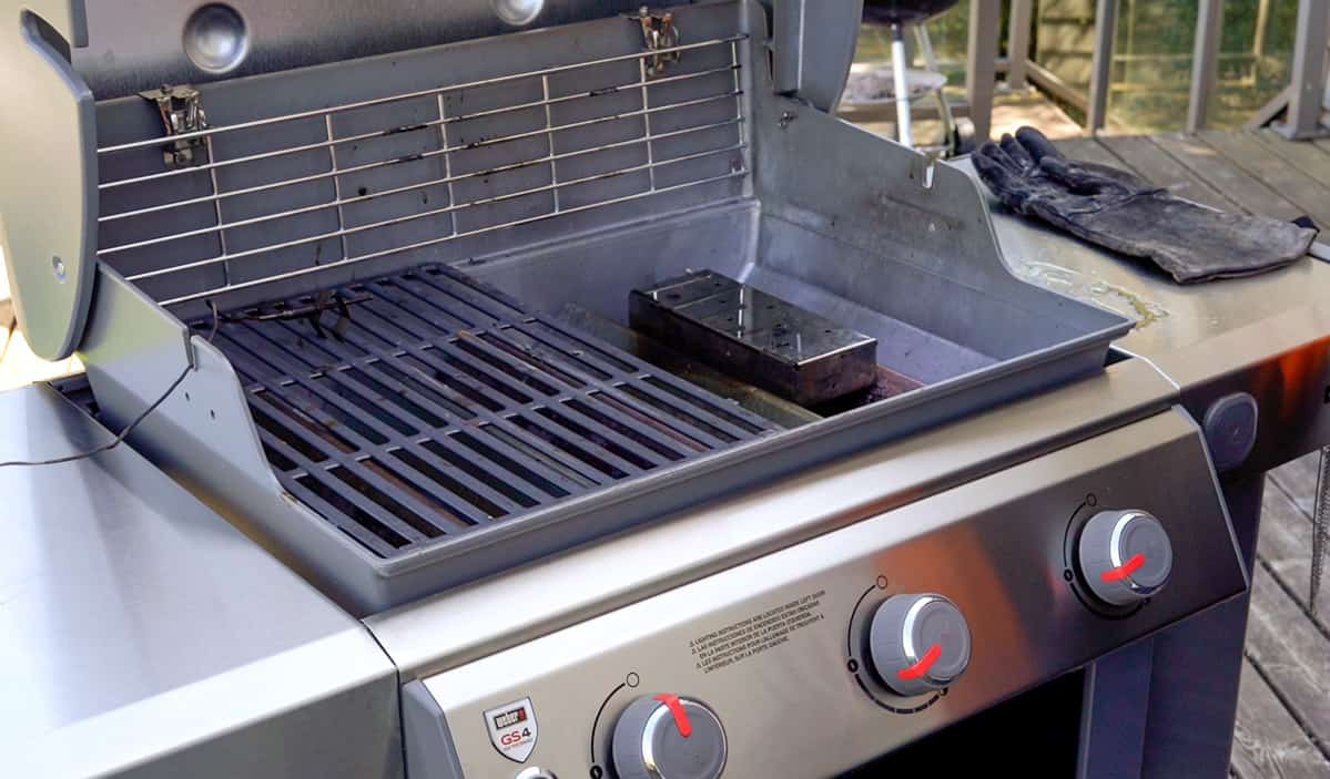 a smoker box on a gas grill