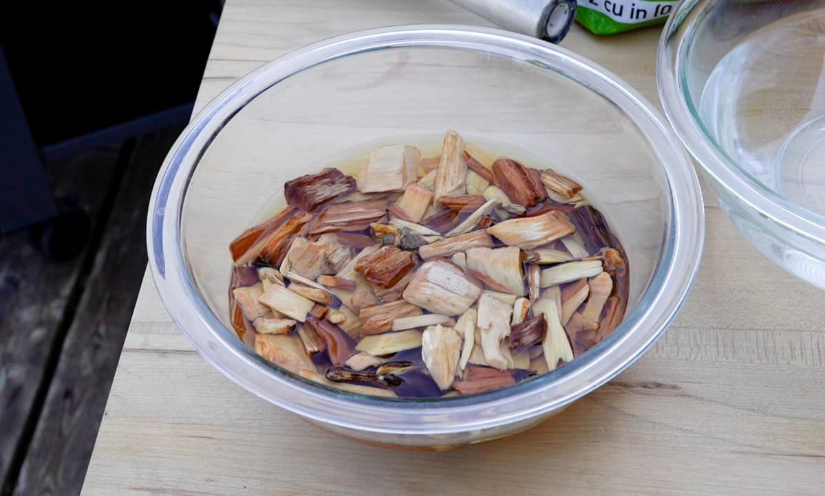wood chips soaking in a glass bowl