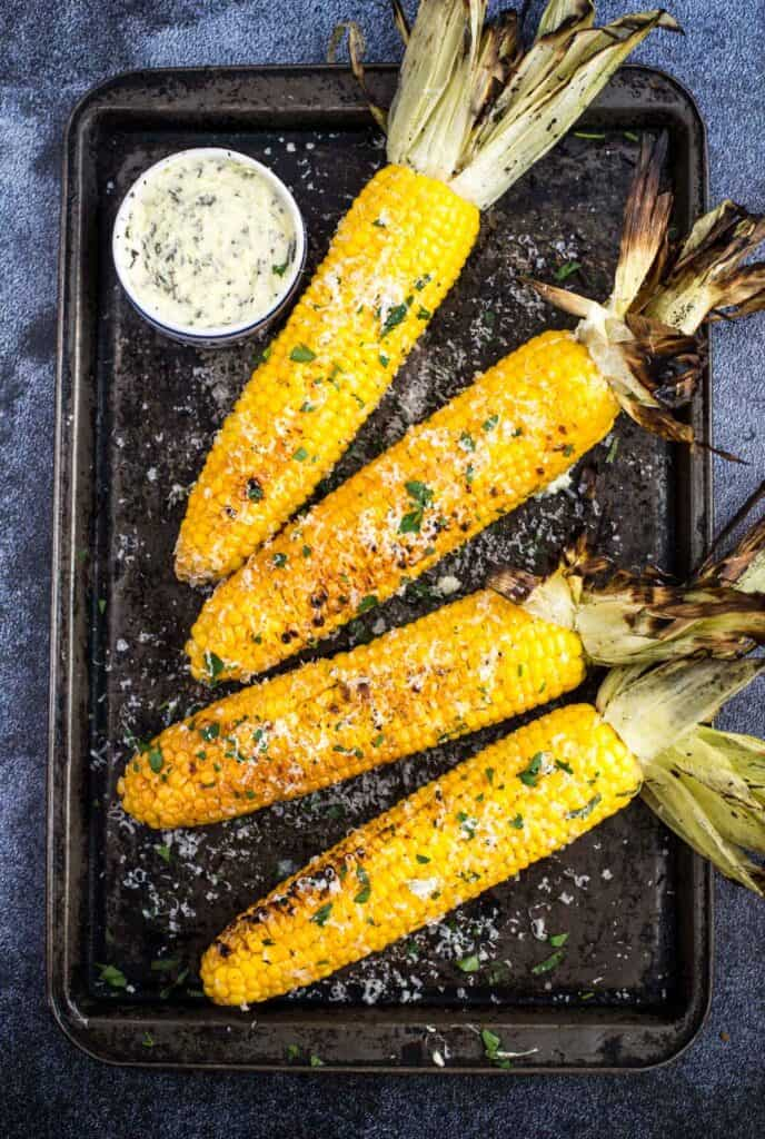 Grilled Corn on the Cob with compound herb butter.
