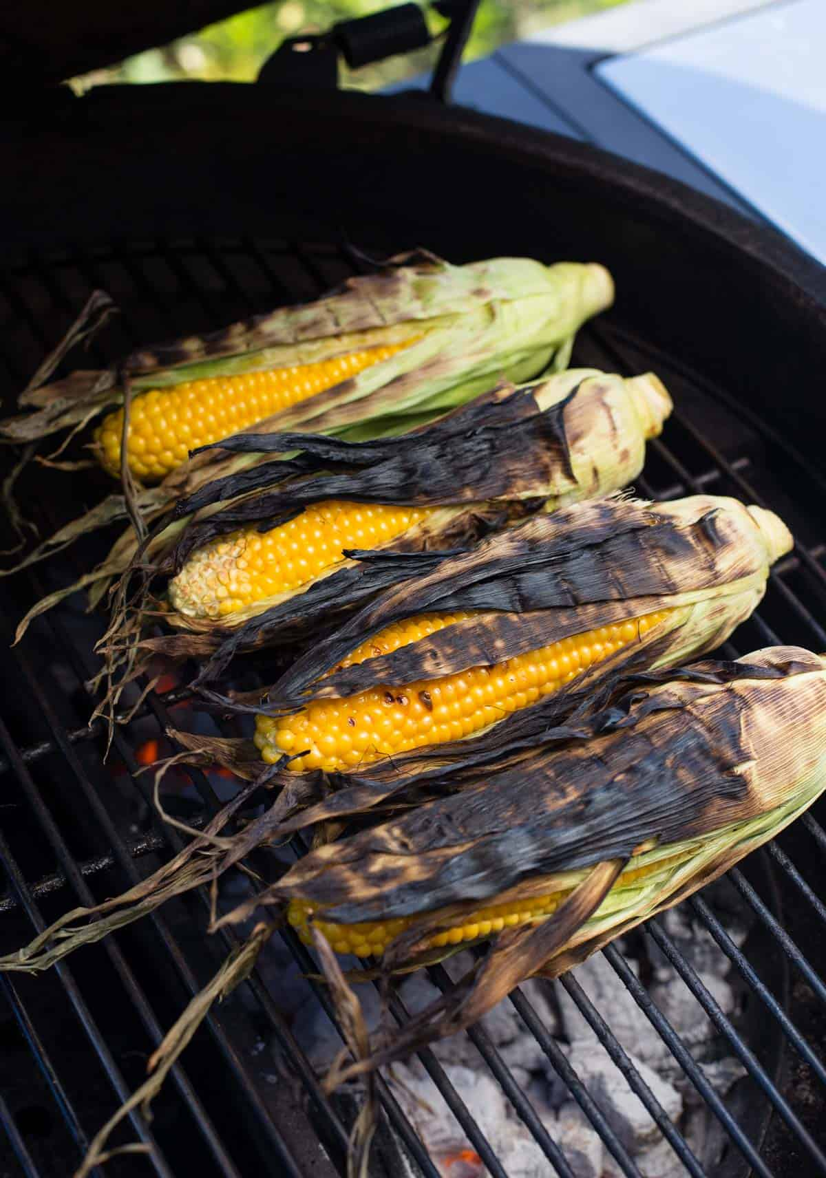 Four ears of corn on a grill