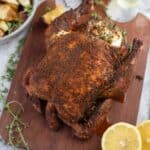 Smoke Roasted Pellet Grill Whole Chicken on a cutting board