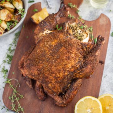 Pellet Grill Whole Chicken on a cutting board.