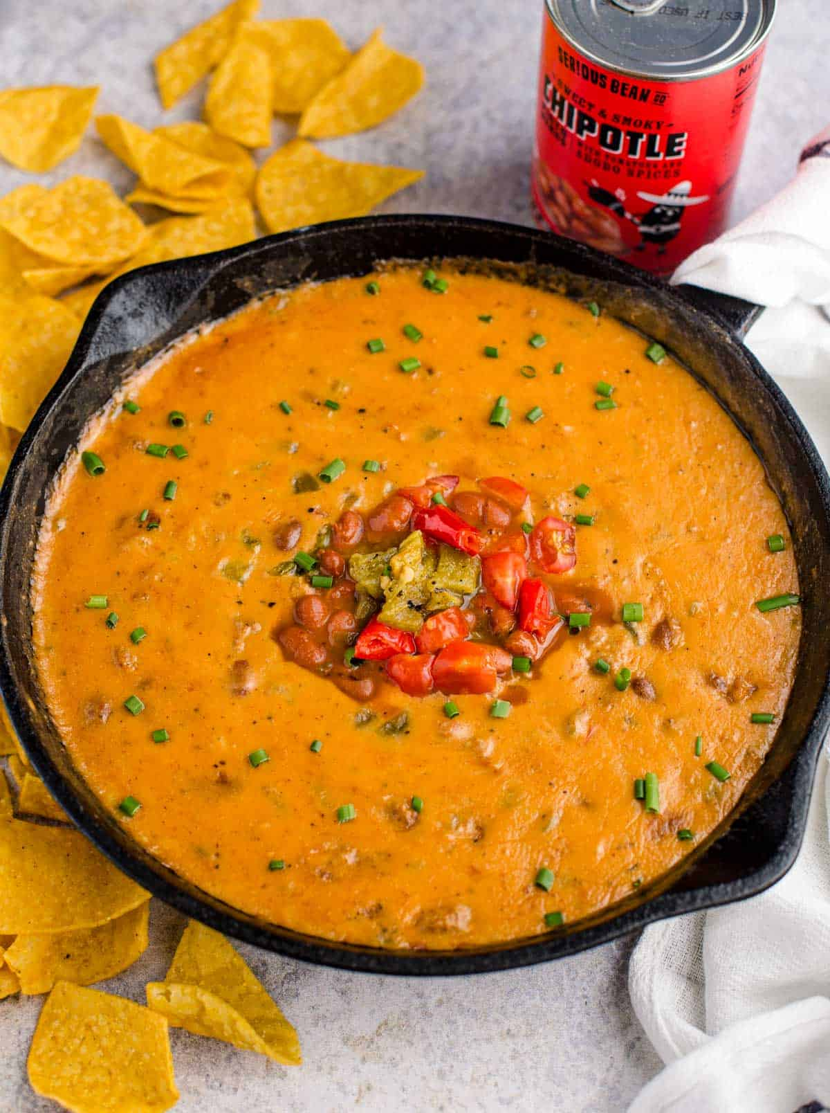 Sausage Queso Bean dip in a cast iron pan