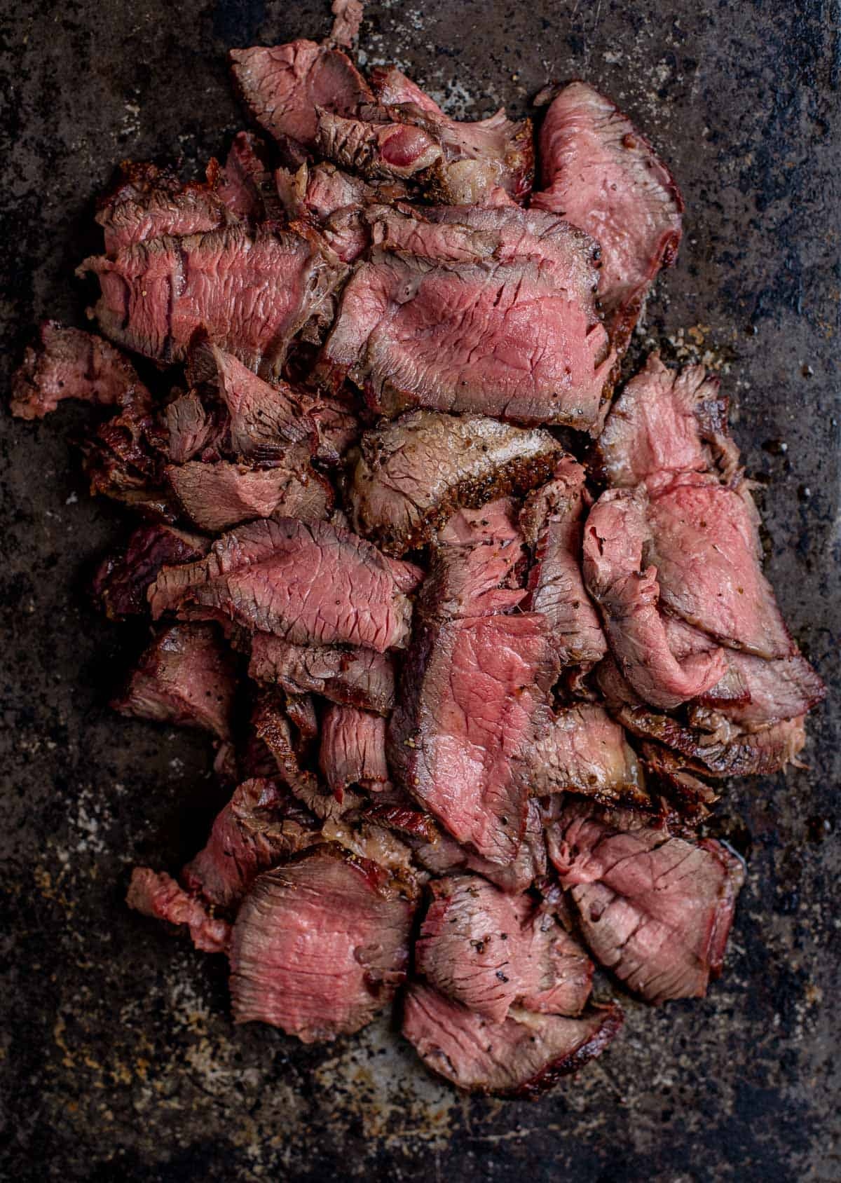 Thin slices of grilled steak for cheesesteak sandwiches