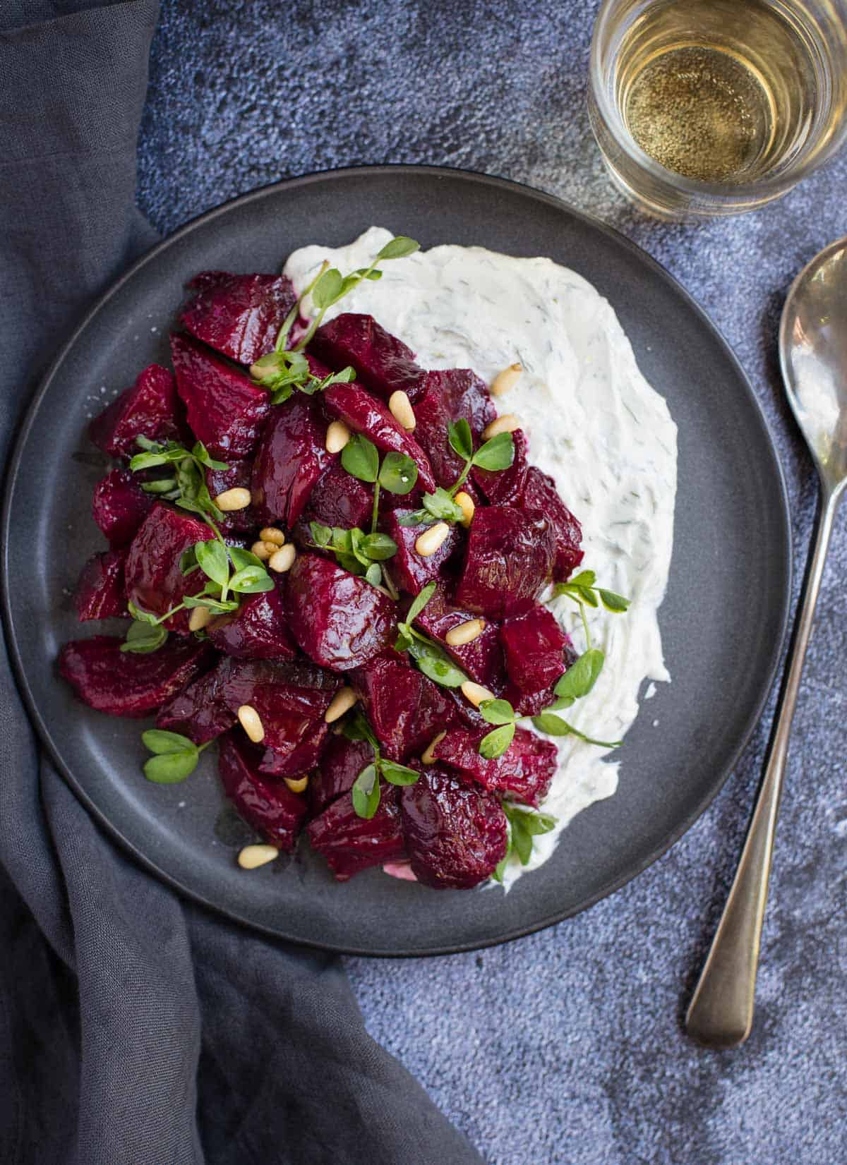 Smoked Beets with Goat Cheese Ranch on a platter with a glass of wine