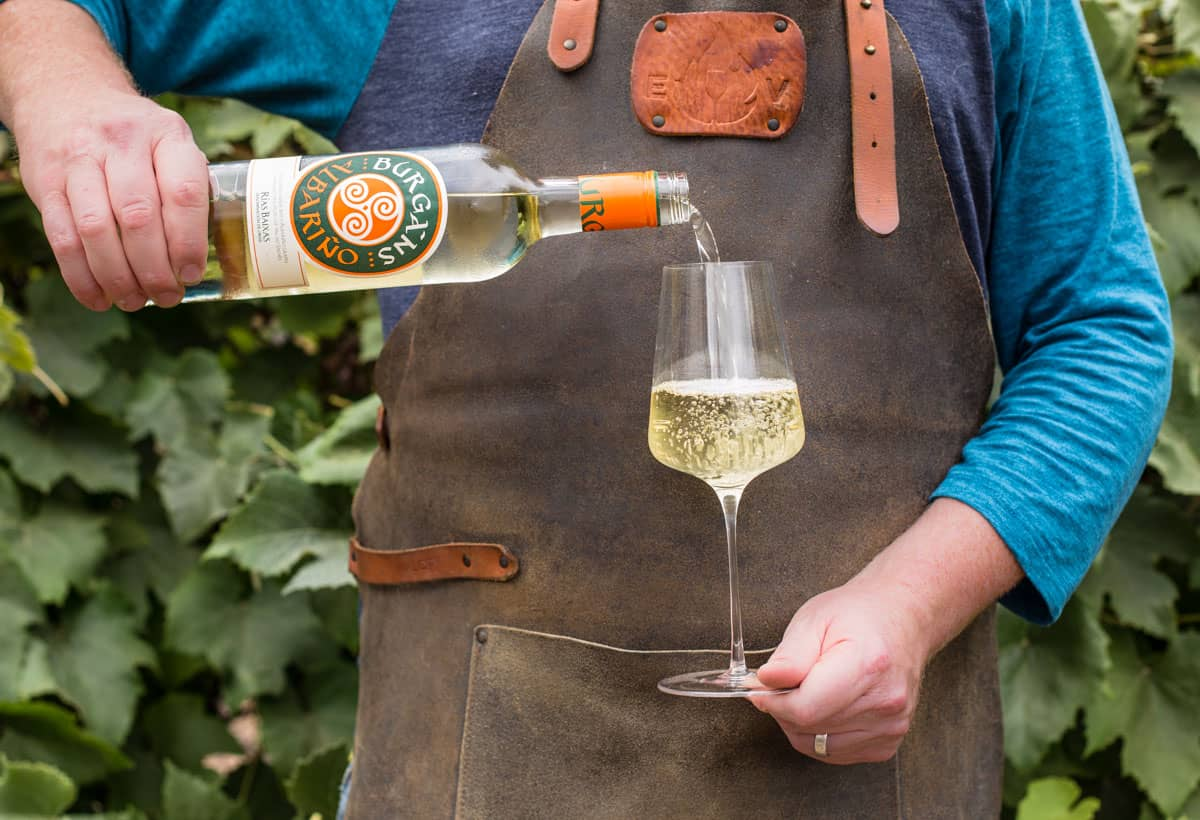 Pouring a glass of Albarino wine
