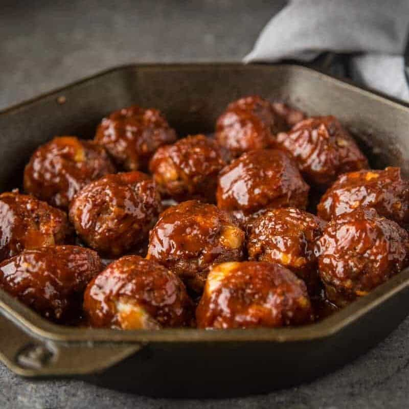 Smoked Stuffed BBQ Meatballs in a cast iron pan