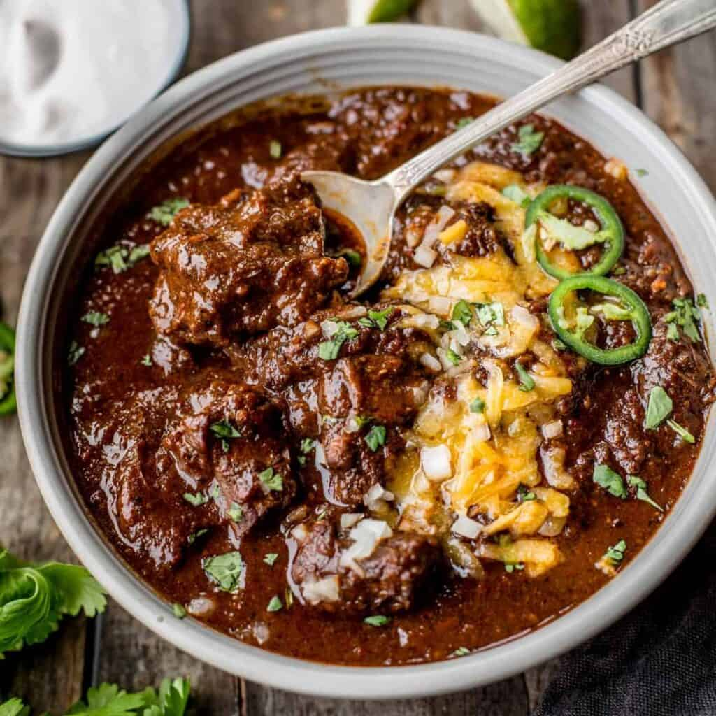 texas chili in a bowl with toppings.
