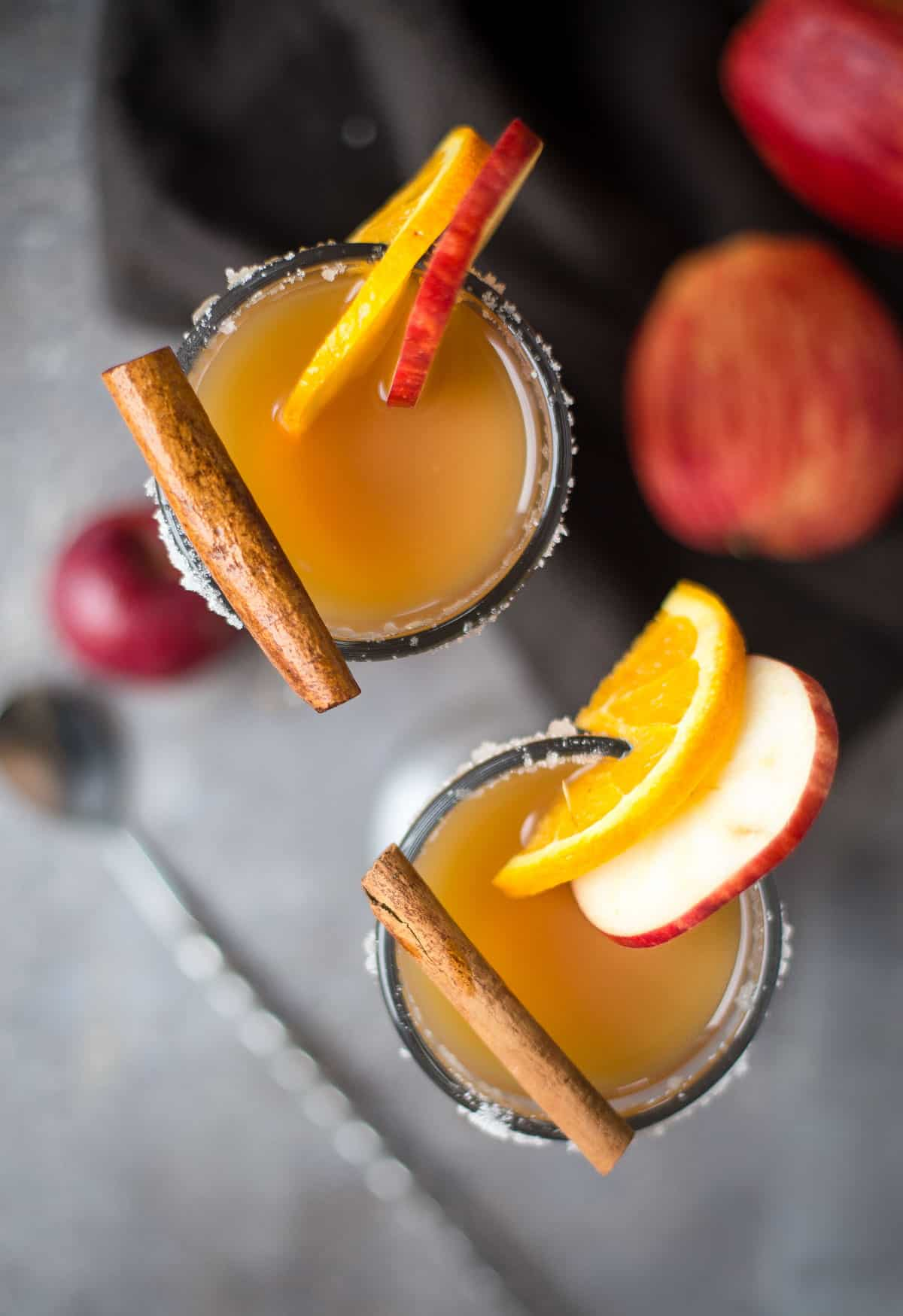 A topdown shot of two Bourbon Spiked Hot Apple Cider drinks