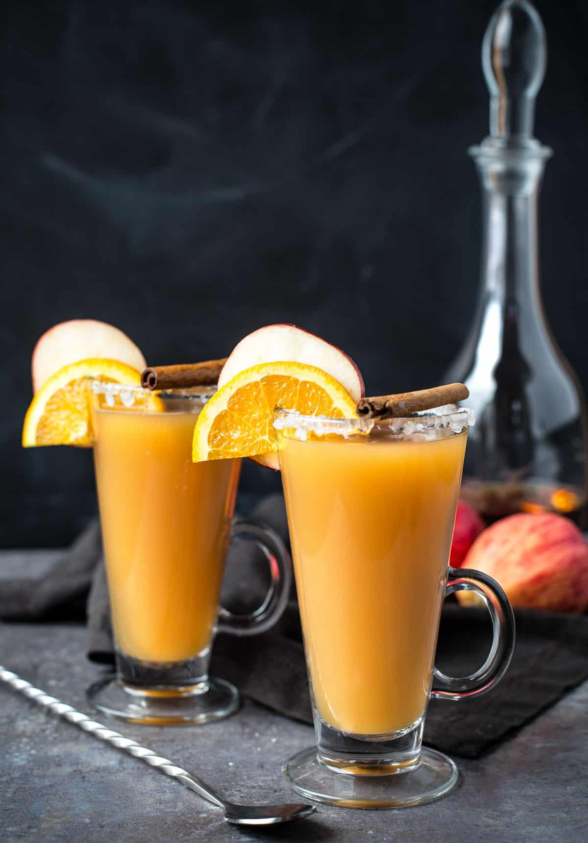 Two glasses of Bourbon Spiked Hot Apple Cider
