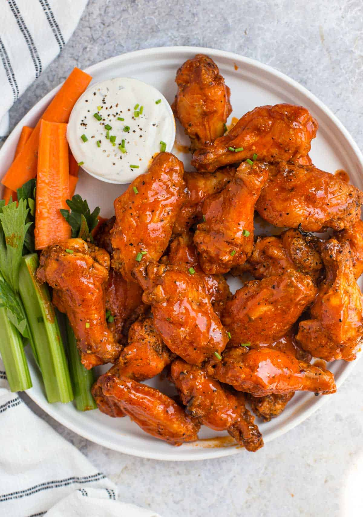 Grilled Buffalo Chicken Wings on a white platter