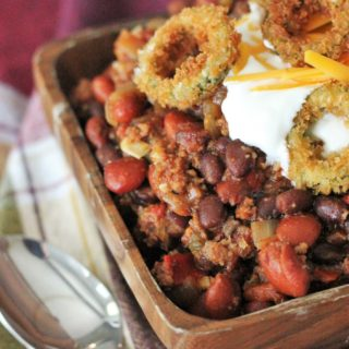 This Smoked Chili gets a hit of smoky flavor from grill-roasted meat and veggies and the fried jalapeno rings hit you with enough spice to make you sweat.