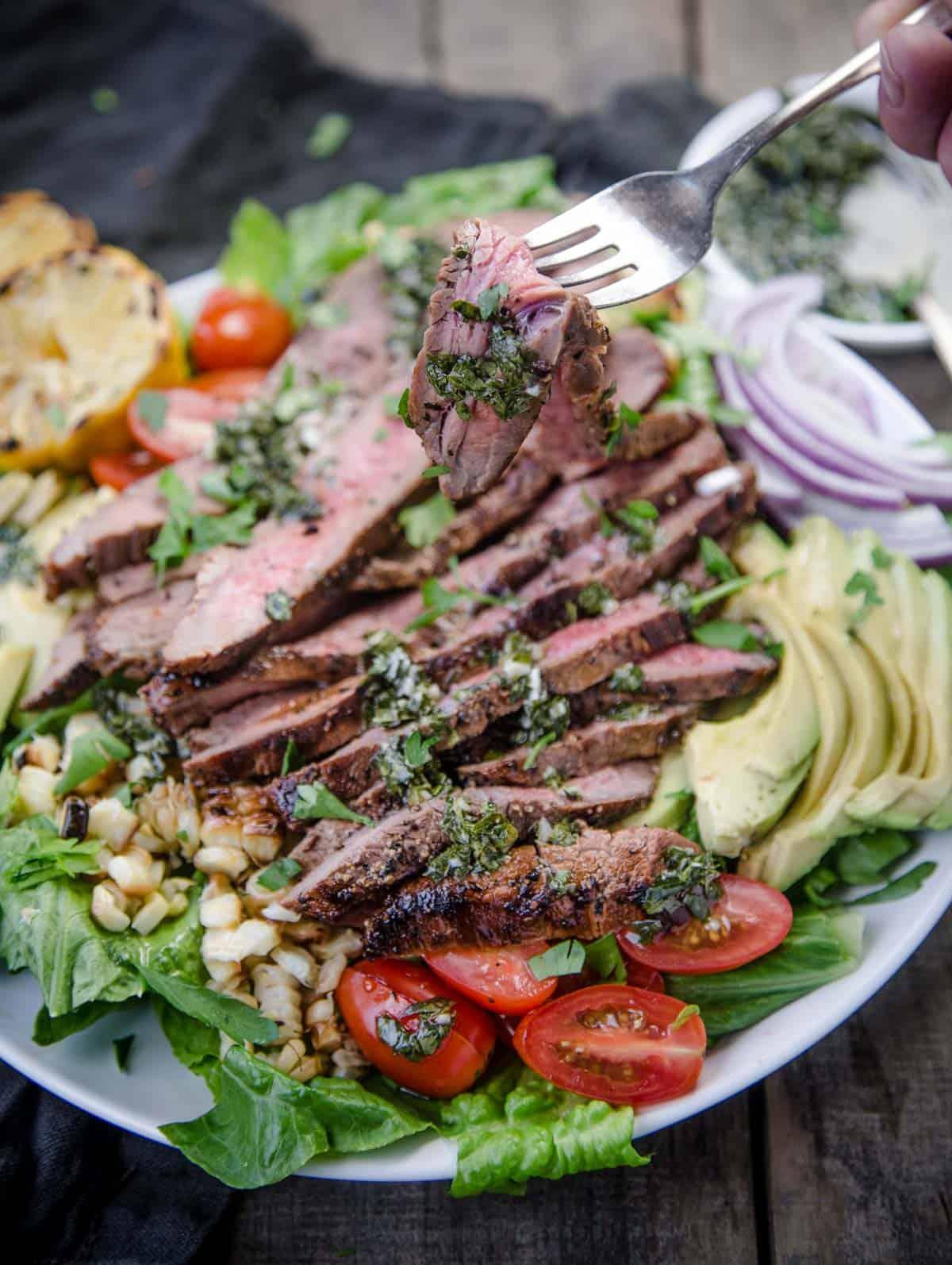 A bite of a steak salad