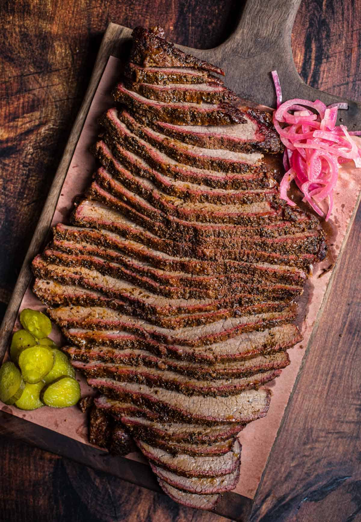 Smoked Brisket Flat slices on a cutting board