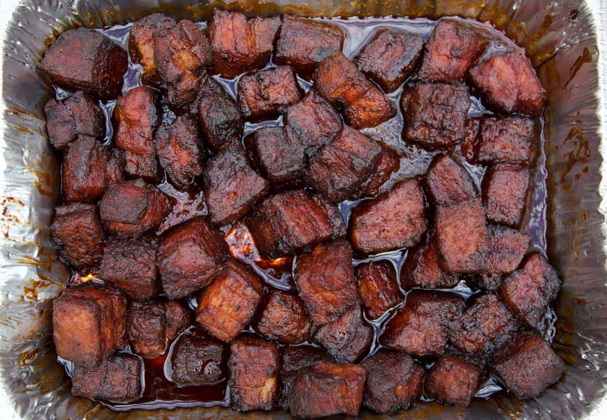 Smoked Pork Belly Burnt ends fully cooked in an aluminum pan
